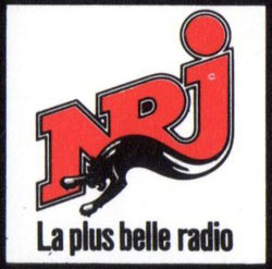 Ancien logo NRJ slogan annees 80 La Plus Belle des Radios partenaire concerts Serge Gainsbourg billet spectacle collection 1988